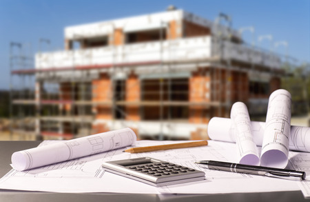 Construction plans with calculator and a shell in the background Banque d'images - 100155113