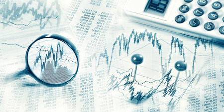 Stock prices as graphs and tables with magnifier and calculator in panoramic format Banque d'images - 100148118