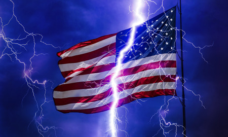 A flash of lightning seems to split an American flag into two parts. Banque d'images - 106196498