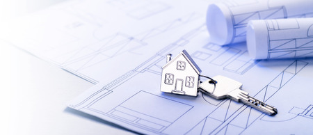 Key with house as a key fob on blueprints in panorama format Stock Photo