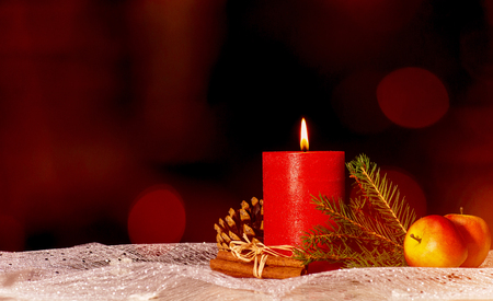 Red candle with christmas decoration and copy space