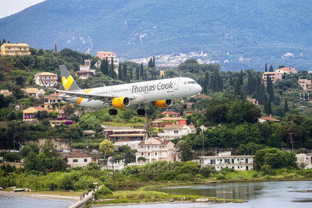 Kerkyra International Airport, Corfu, Greece - June 21, 2018: Airbus A321 of Thomas Cook Airlines (G-TCDK) when landing on Corfu