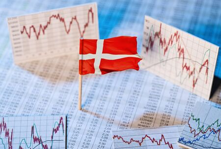 Danish flag with course tables and graphs on economic development