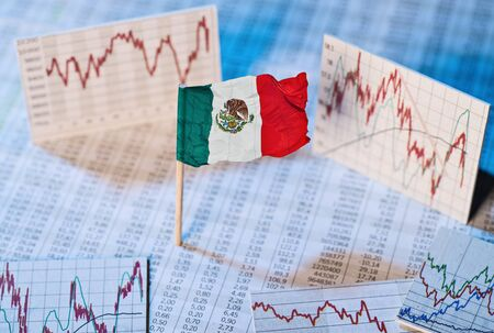 Mexican flag with exchange rate tables and graphs on economic development