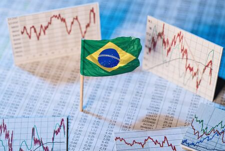 Brazilian flag with course tables and graphs on economic development