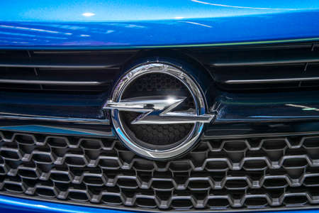The logo of Opel on a blue car of this brand Editorial
