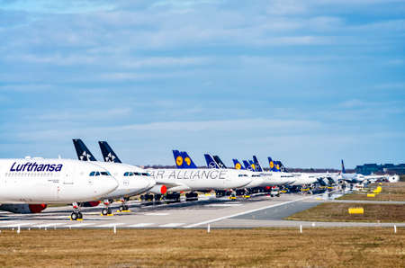 Lufthansa aircraft (Airbus A330 and 340) are parked on the north-west runway of Frankfurt Airport as a result of the corona pandemic. Frankfurt, Hessen / Germany - March 30 2020
