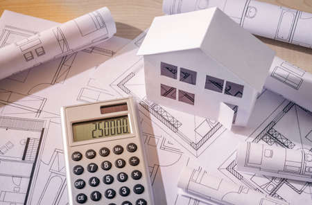 Architecture model with construction plans and calculator