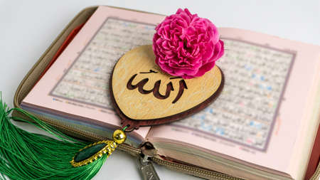 "The Holy Quran and Heart(Love) Shaped Tag written in Arabic ""Allah"" English meaning of God"