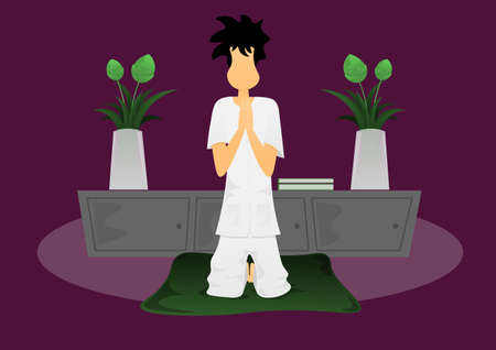 a guy holding hand pray on cushion in room