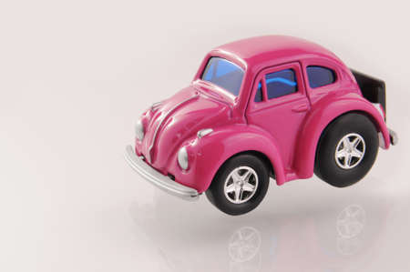 Pink toy car  photo