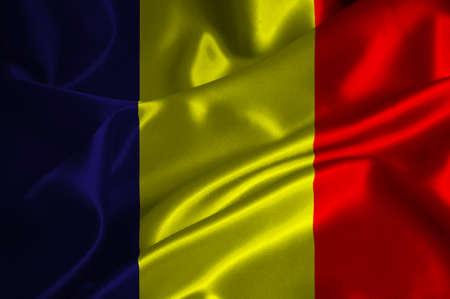 chadian: Chad flag on satin texture. Stock Photo