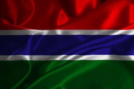 Gambia flag on satin texture. Stock Photo
