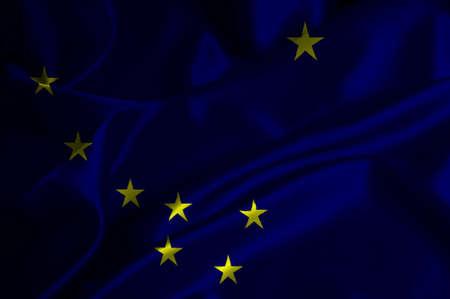Alaska flag on satin texture