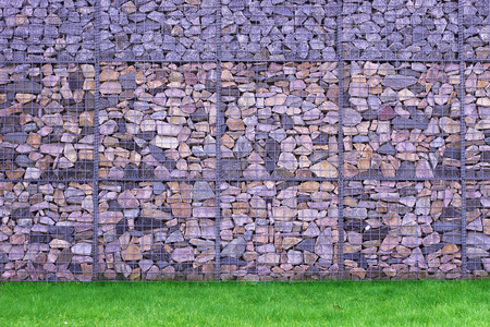 perfomance: Colorful Abstract Stone Wall perfomance art on grass Stock Photo