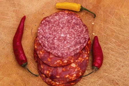 chorizo: Chorizo Sausages salamy Paprika on wooden table Stock Photo
