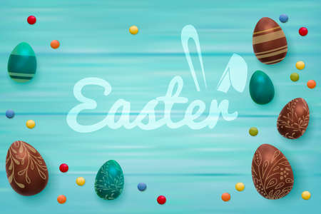 Easter composition with chocolate eggs on color wooden background, Easter greeting text with funny bunny ears.
