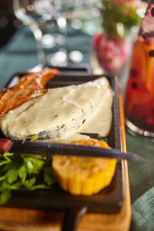 Steak from salmon with sauce and a decanter of a berry drink Foto de archivo
