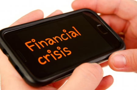 Financial crisis on mobile phone isolated Stock Photo - 13601465