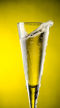 Glass of Champagne with yellow background Stock Photo - 13599448