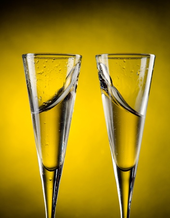 Two glass of champagne with yellow background Stock Photo - 13599678