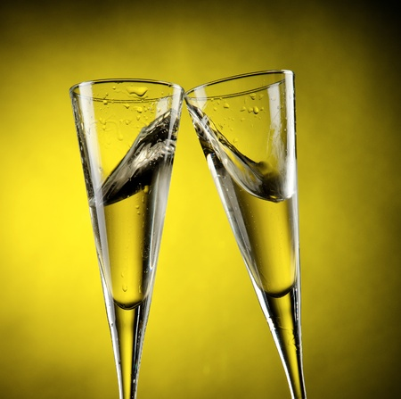 Two glass of champagne with yellow background Stock Photo - 13601223