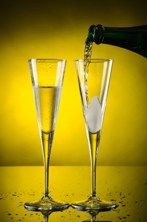 Two glass champagne isolated on yellow photo