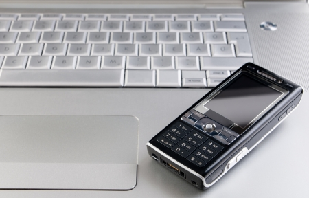 Business concept with laptop and mobile phone photo