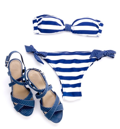 Striped bikini and spotted sandal with white background photo