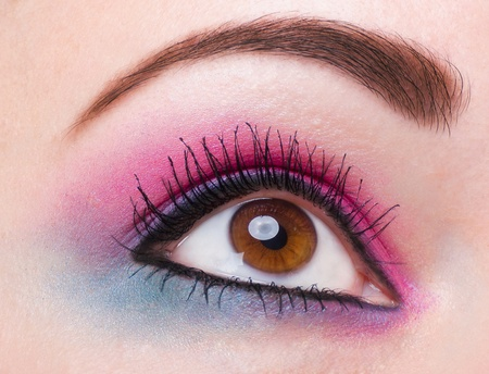 ceremonial make up: pink and blue makeup of a female eye Stock Photo