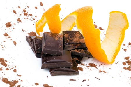 Close-up of chocolate pieces with orange isolated photo