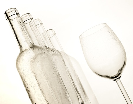 Winebottles and glass with white background photo