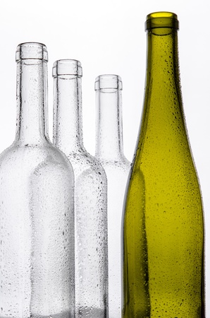 Wine bottles with water drops photo