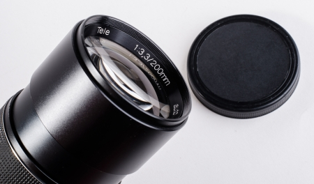 telezoom: Camera lens with white background