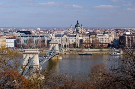City view with river, buildings and bridge photo