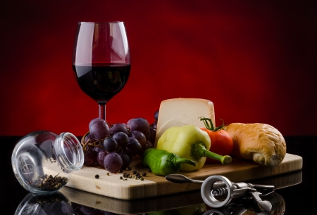 Table of various food with red wine photo