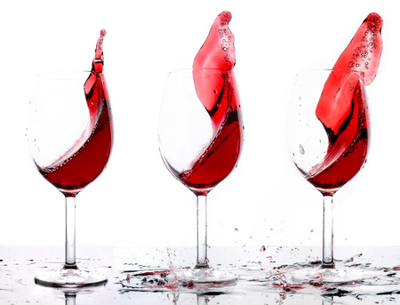 Three glasses of red wine, isolated photo