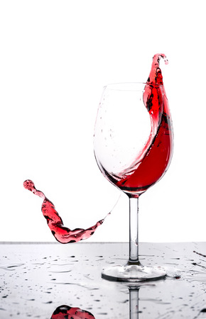 Red wine splash isolated on white Stock Photo - 23382522