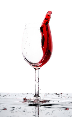 Glass of red wine splash isolated Stock Photo - 23382528