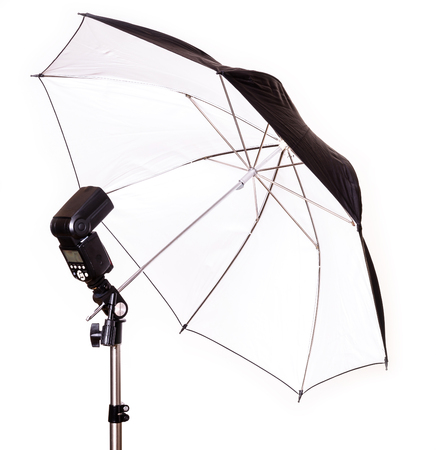 Studio strobe with umbrella isolated on the white photo