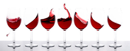 red wines in a row with white background