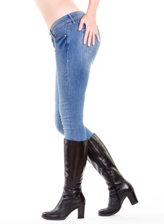 Woman legs in boots isolated on white photo