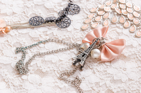 Parisian ccessories on lace photo