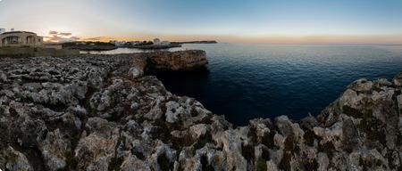 Panorama with rocks at sunrise photo