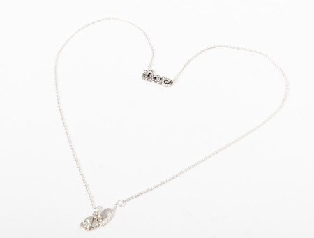 Heart necklace with love label isolated