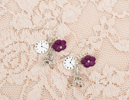 using senses: Earring with eiffel shape on lace