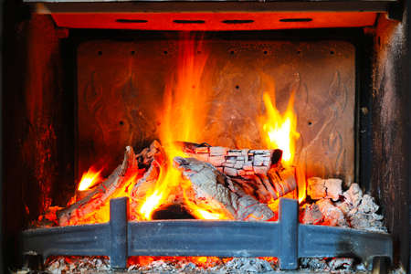 Burning wood in the fireplace Stock Photo