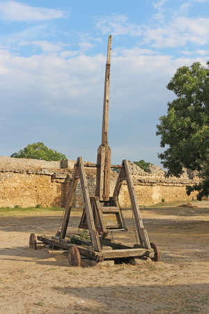 Trebuchet. Ancient wooden catapult for destroying the castle walls