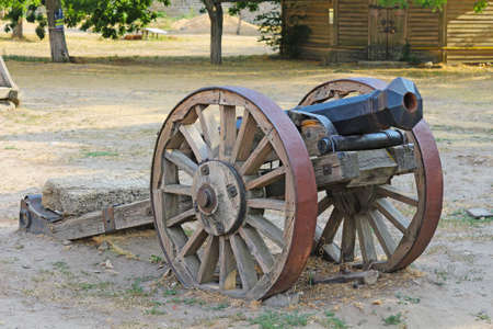 Old cannon on wheels. Military weapon