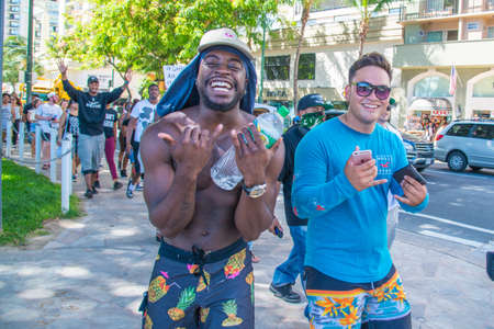 mere: Honolulu, HI.  July 9, 2016.  Approximately fifty or so Black Lives Matter protesters hit the strip in Waikiki on Saturday afternoon with chants of �hands up don�t shoot�,  a mere 48 hours after five white poli Editorial